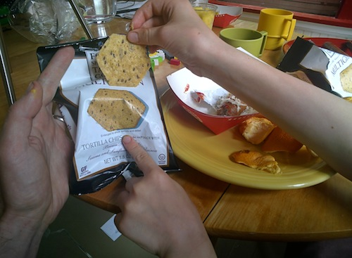 Tortilla chip and bag with picture of chip.