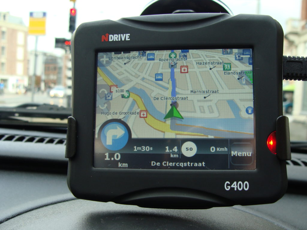 A GPS map unit on the dashboard of a car