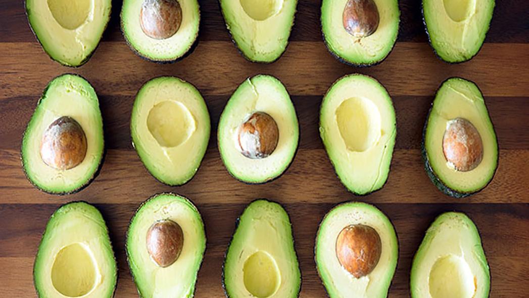 15 avocados on a cutting board