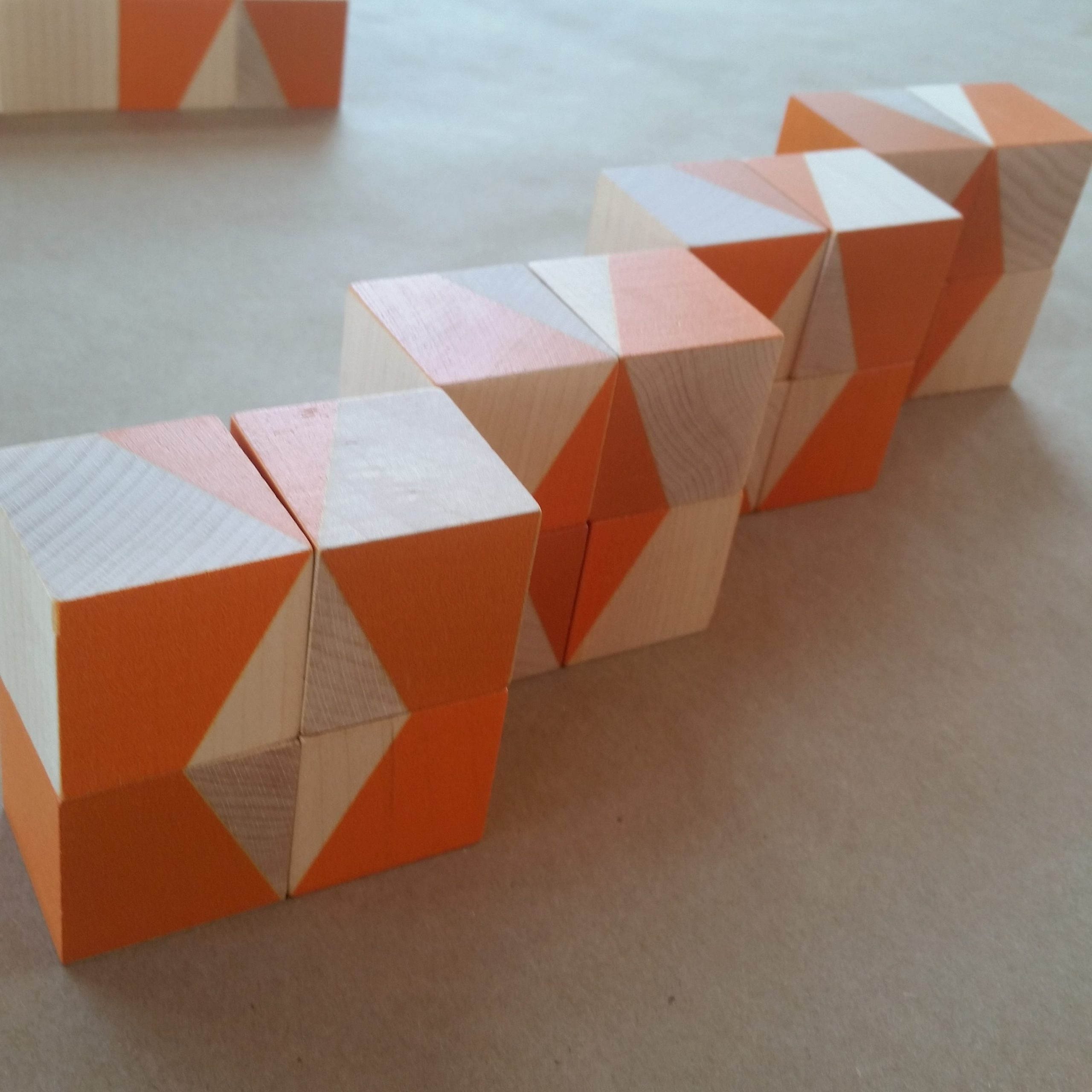 Orange and natural wood blocks with geometric patterns