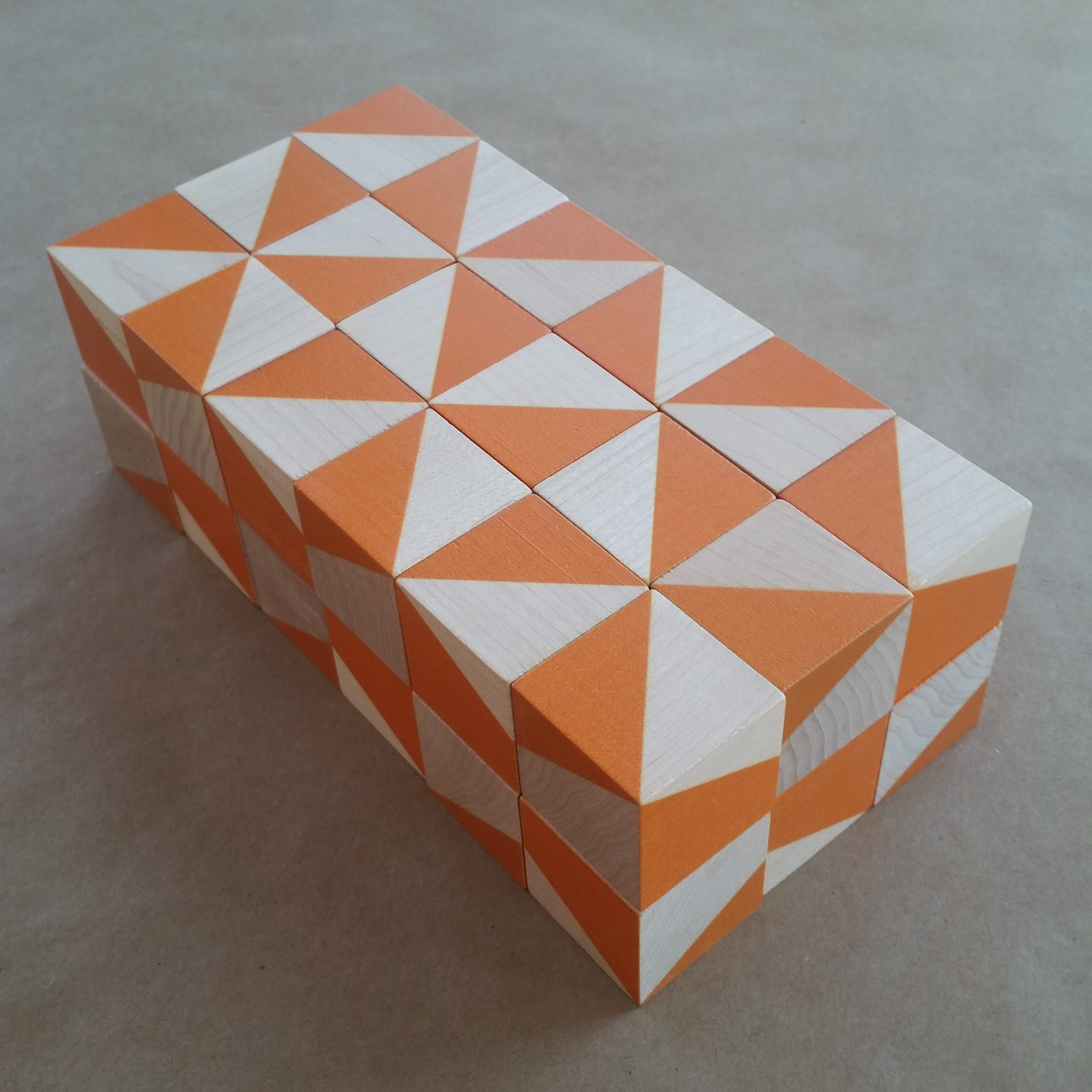 3 by 6 by 2 prism of orange and natural maple geometric blocks